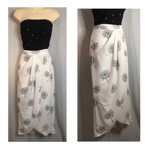 """A """"floaty"""" midi skirt. White with black flowers"""